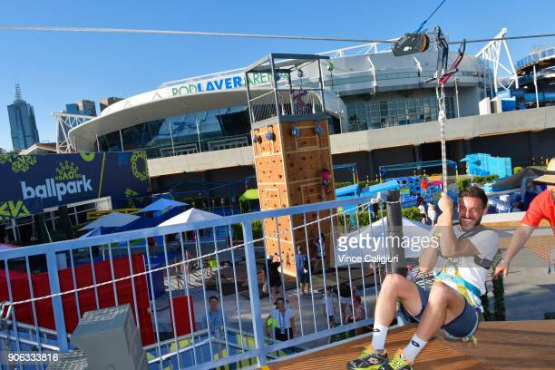 Damir Dzumhur of Bosnia takes a ride on the zip wire at AO Ball Park during day four of the 2018 Australian Open at Melbourne Park on January 18 2018...