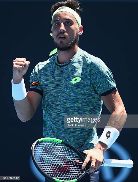Damir Dzumhur of BosniaHerzegovina celebrates during his first round match against Viktor Troicki of Serbia on day one of the 2017 Australian Open at...