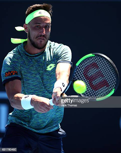 Damir Dzumhur of BosniaHerzegovina plays a backhand in his first round match against Viktor Troicki of Serbia on day one of the 2017 Australian Open...