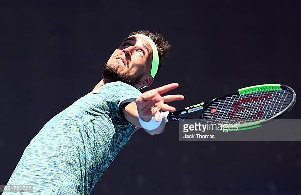 Damir Dzumhur of BosniaHerzegovina serves during his first round match against Viktor Troicki of Serbia on day one of the 2017 Australian Open at...