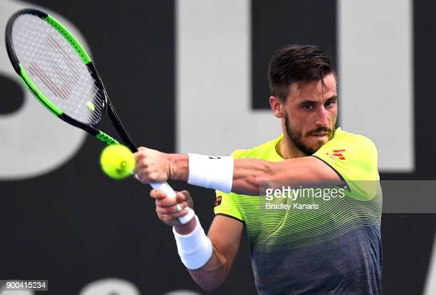 Damir Dzumhur plays a backhand in his match against Denis Istomin during day three of the 2018 Brisbane International at Pat Rafter Arena on January...