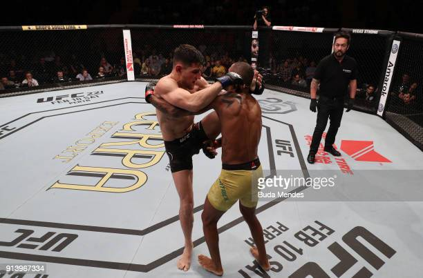 Damir Hadzovic of Bosnia knees Alan Patrick of Brazil in their lightweight bout during the UFC Fight Night event at Mangueirinho Arena on February 03...