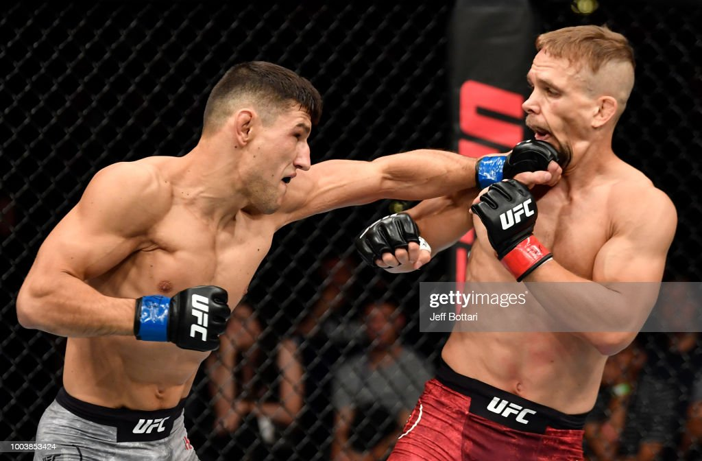 Damir Hadzovic of Bosnia punches Nick Hein of Germany in their lightweight bout during the UFC Fight Night at Barclaycard Arena on July 22, 2018 in Hamburg, Germany.