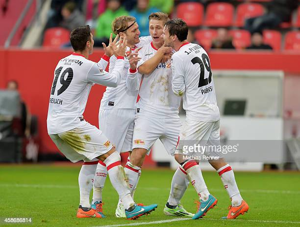 Damir Kreilach Martin Dausch Sebastian Polter and Michael Parensen of 1 FC Union Berlin celebrate after scoring the 23 during the game between FC...