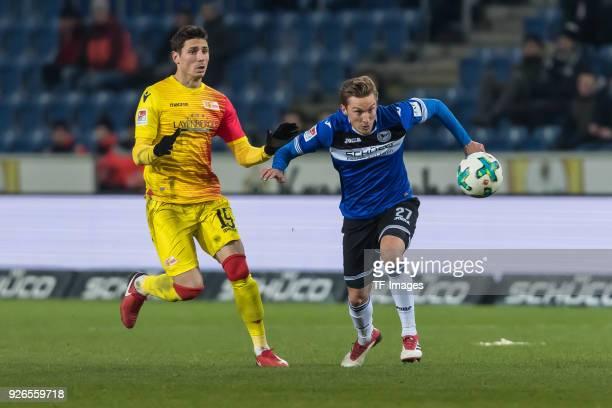 Damir Kreilach of Berlin and Konstantin Kerschbaumer of Bielefeld battle for the ball during the Second Bundesliga match between Arminia Bielefeld...