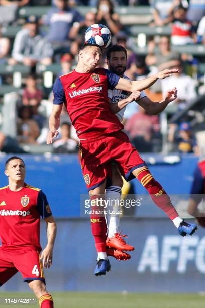 Damir Kreilach of Real Salt Lake and Chris Pontius of Los Angeles Galaxy go up for a header during a game at Dignity Health Sports Park on April 28...