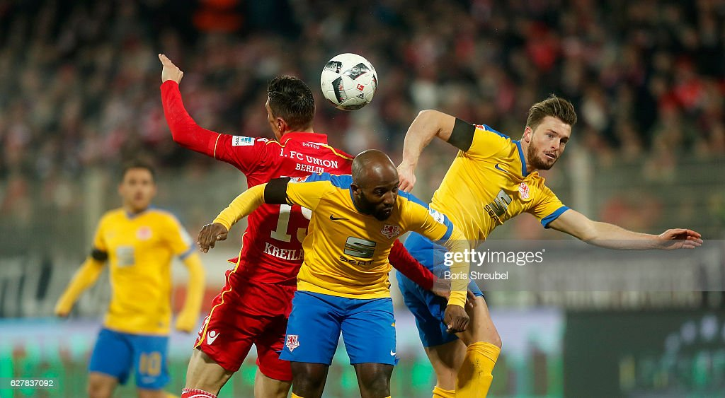 Damir Kreilach (L) of Union Berlin jumps for a header with Domi Kumbela (C) and Quirin Moll of Eintracht Brauschweig during the Second Bundesliga match between 1. FC Union Berlin and Eintracht Braunschweig at Stadion An der Alten Foersterei on December 5, 2016 in Berlin, Germany.