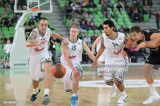 Damir Markota #22 of Union Olimpija Ljubljana Sasu Salin #13 of Union Olimpija Ljubljana and Danny Green #14 of Union Olimpija Ljubljana compete with...