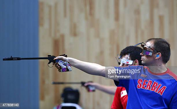 Damir Mikec of Serbia shoots during the Men's Pistol Shooting 50m final on day eight of the Baku 2015 European Games at the Baku Shooting Centre on...