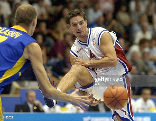 Damir Mulaomerovic of Croatia dribbles past Sergey Balashov of Ukraine during their Group D first round match at the European Basketball...