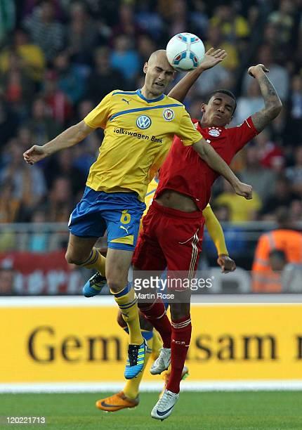 Damir Vrancic of Braunschweig and Luiz Gustavo of Muenchen head for the ball during the DFB Cup first round match between Eintracht Braunschweig and...