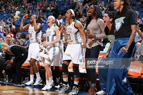 Damiris Dantas Lindsey Moore Maya Moore Devereaux Peters Janel McCarville Seimone Augustus of the Minnesota Lynx react to the play against the...