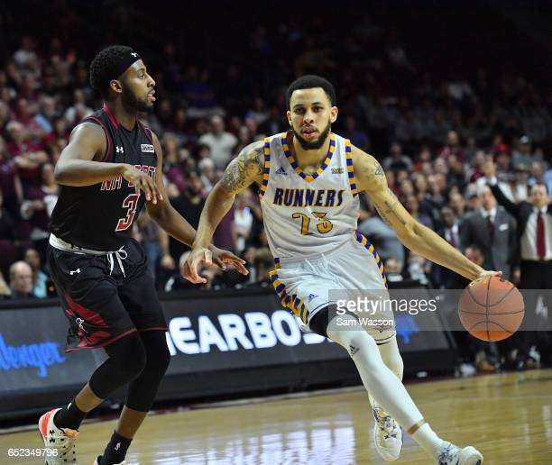 Damiyne Durham of the Cal State Bakersfield Roadrunners drives against Chancellor Ellis of the New Mexico State Aggies during the championship game...