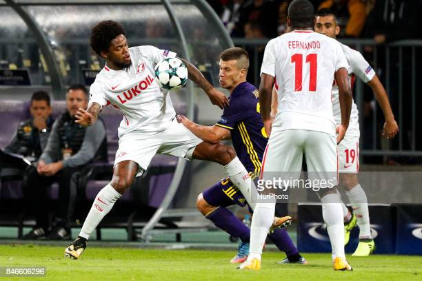 Damjan Bohar of NK Maribor challenges Luis Adriano of Spartak Moskva during the UEFA Champions League Group E match between NK Maribor and Spartak...