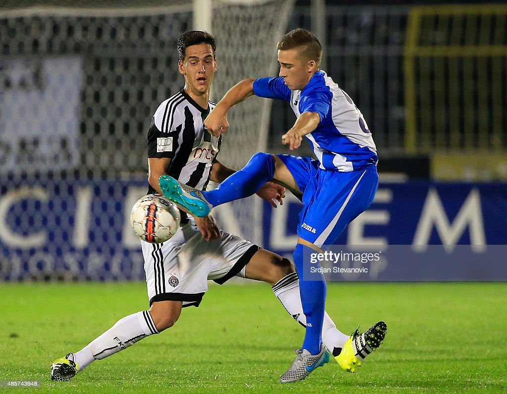 BELGRADE, SERBIA - AUGUST 29. Damjan Gojkov (R) of OFK Belgrade in action against Marko Jevtovic (L) of FK Partizan during the Serbia Super League match between FK Partizan and OFK Belgrade at Partizan stadium August 29, 2015 in Belgrade, Serbia.