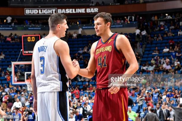 Damjan Rudez of the Orlando Magic and Ante Zizic of the Cleveland Cavaliers shake hands after the preseason game on October 13 2017 at Amway Center...