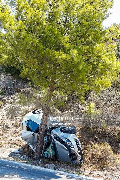 A dammaged car that had a severe accident and smashed into a pine tree on August 23 2012 in Rhodes Greece Rhodes is the largest of the Greek...