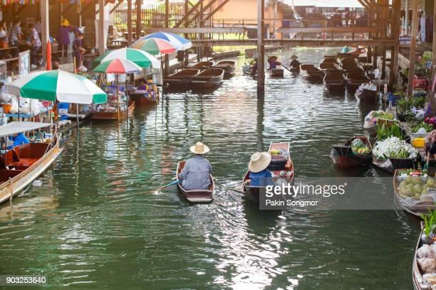 damnoen saduak floating market - village stock pictures, royalty-free photos & images