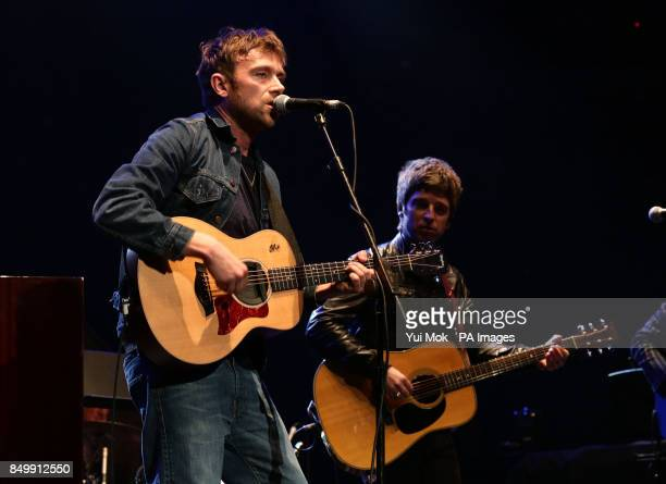 Damon Albarn and Noel Gallagher performing on stage during their Teenage Cancer Trust gig at the Royal Albert Hall in London