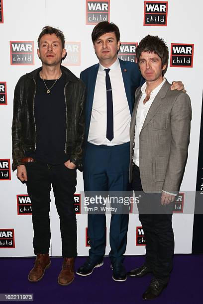 Damon Albarn and Noel Gallagher pose in the press room at the Brit Awards 2013 at the 02 Arena on February 20 2013 in London England
