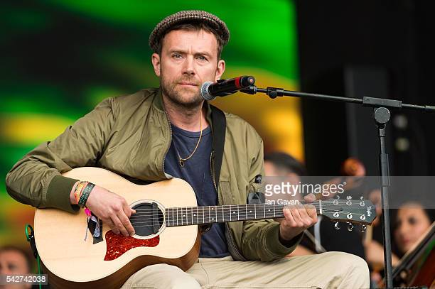 Damon Albarn and The Orchestra of Syrian Musicians perform on the Pyramid Stage at the Glastonbury Festival at Worthy Farm Pilton on June 24 2016 in...