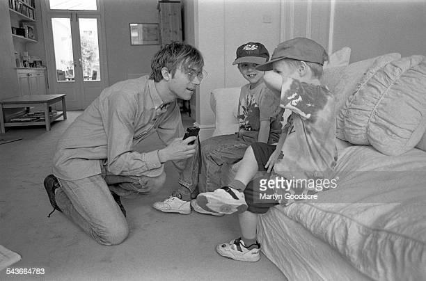 Damon Albarn of Blur with record producer Stephen Street's children at Street's house London United Kingdom 1995