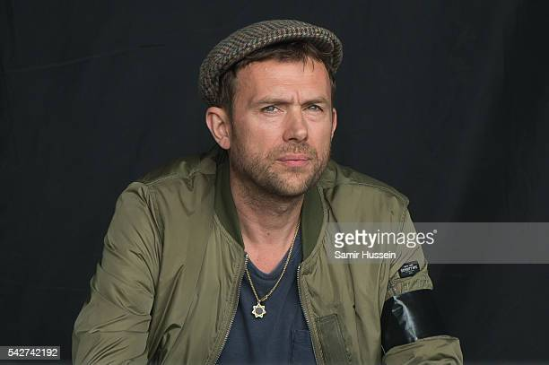 Damon Albarn performs with The Orchestra of Syrian Musicians at Glastonbury Festival 2016 at Worthy Farm Pilton on June 24 2016 in Glastonbury England
