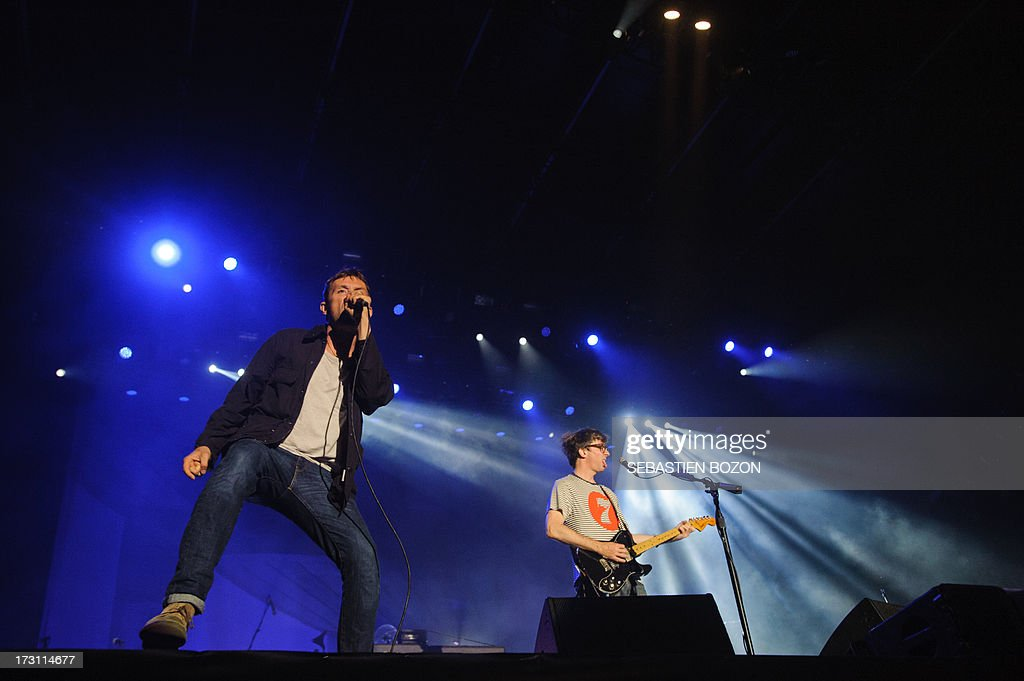 Damon Albarn (L), singer of British band Blur, performs on July 7, 2013 at the Eurockeennes festival in the eastern French city of Belfort.