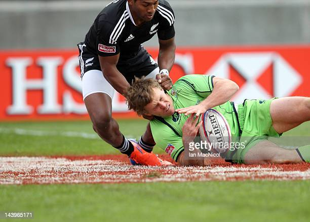 Damon Anderson of Australia scores a try during the Australia and New Zealand match during day two of the IRB Glasgow Sevens at Scotstoun Stadium on...