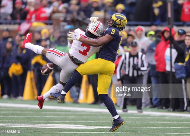 Damon Arnette of the Ohio State Buckeyes battles with Donovan PeoplesJones of the Michigan Wolverines for the ball during the third quarter of the...
