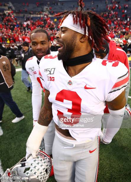Damon Arnette of the Ohio State Buckeyes celebrates a 5627 win over the Michigan Wolverines with KJ Hill of the Ohio State Buckeyes at Michigan...
