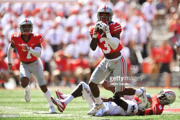 Damon Arnette of the Ohio State Buckeyes intercepts a pass against the UNLV Rebels in the second quarter at Ohio Stadium on September 23 2017 in...