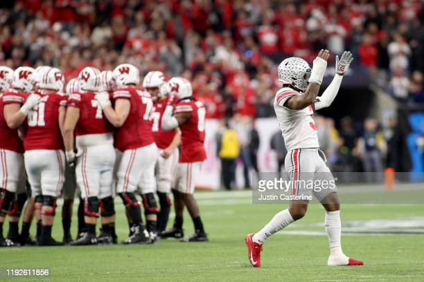 Damon Arnette of the Ohio State Buckeyes waves his hands up to the crowd during the Big Ten Championship against the Wisconsin Badgers at Lucas Oil...