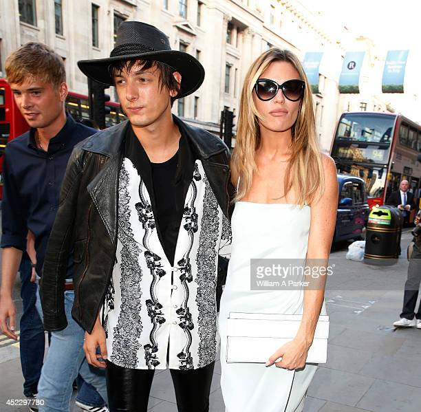 Damon Baker and Abbey Clancy arrive at The Watches Of Switzerland store launch party on July 17 2014 in London England