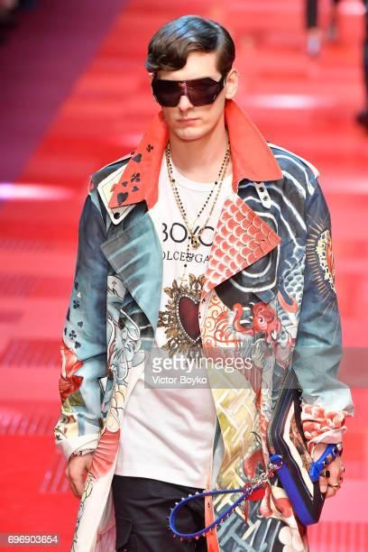 Damon Baker walks the runway at the Dolce Gabbana show during Milan Men's Fashion Week Spring/Summer 2018 on June 17 2017 in Milan Italy