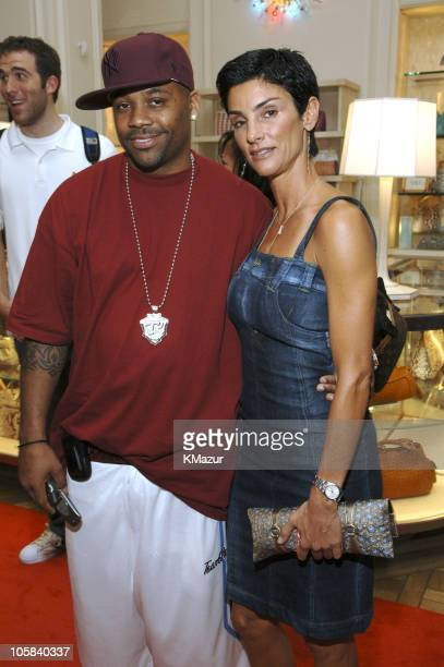 Damon Dash and Ingrid Casares during Lotsa De Casha by Madonna Book Party at Bergdorf Goodman Inside at Bergdorf Goodman in New York City New York...
