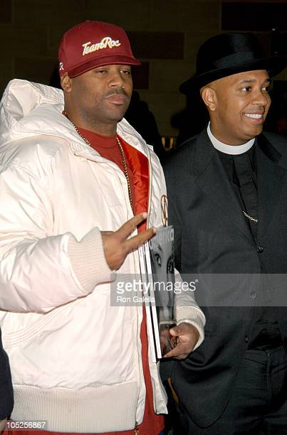 Damon Dash and Reverend Run during Olympus Fashion Week Fall 2004 Baby Phat Front Row and Backstage at Gotham Hall in New York City New York United...