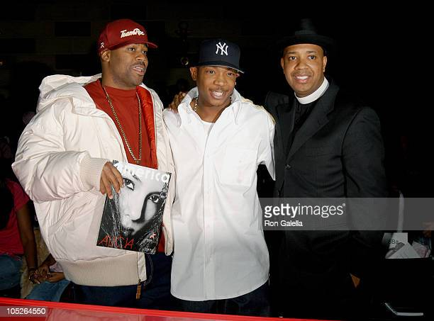 Damon Dash Ja Rule and Reverend Run during Olympus Fashion Week Fall 2004 Baby Phat Front Row and Backstage at Gotham Hall in New York City New York...
