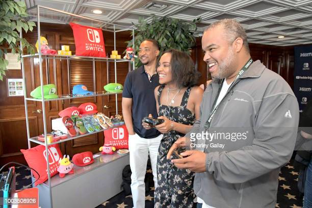 Damon Gupton and China Anne McClain test their skills on Super Smash Bros Ultimate for Nintendo Switch at the Variety Studio at ComicCon 2018 on July...
