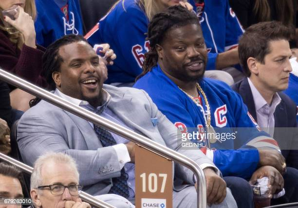 Damon Harrison and friend attend Ottawa Senators Vs New York Rangers 2017 Playoffs Game 4 at Madison Square Garden on May 4 2017 in New York City