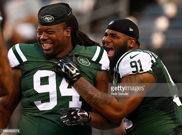 Damon Harrison and Sheldon Richardson of the New York Jets laugh on the field before a preseason game against the Philadelphia Eagles at MetLife...