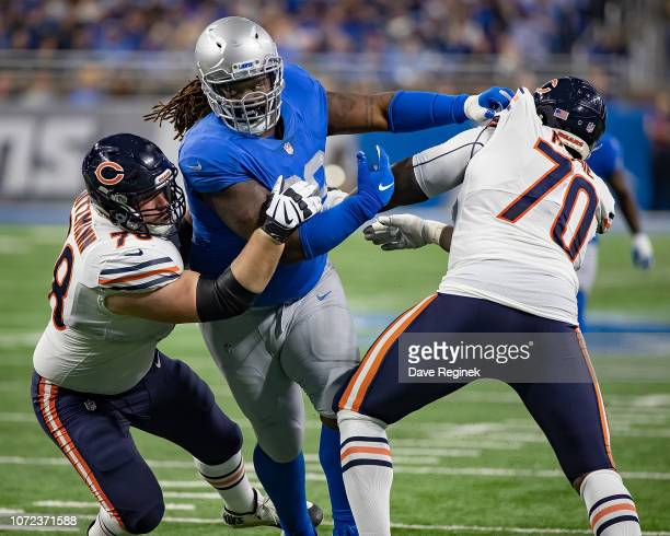 Damon Harrison of the Detroit Lions battles with Bryan Witzmann and Bobby Massie of the Chicago Bears during an NFL Thanksgiving Day game at Ford...