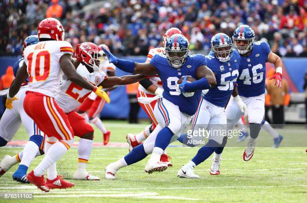 Damon Harrison of the New York Giants catches a fumble as aresult from a hit by Jason PierrePaul of the New York Giants on Travis Kelce of the Kansas...