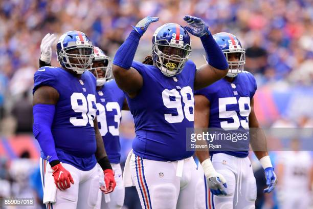 Damon Harrison of the New York Giants pumps up the crowd during the first quarter against the Los Angeles Chargers during an NFL game at MetLife...