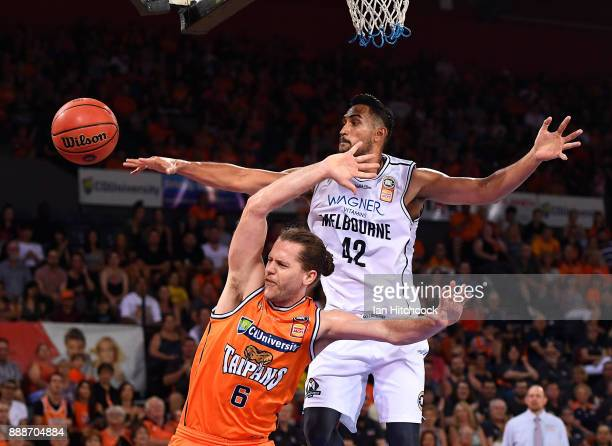 Damon Heir of the Taipans and Tai Wesley of Melbourne United contest the ball during the round nine NBL match between the Cairns Taipans and...