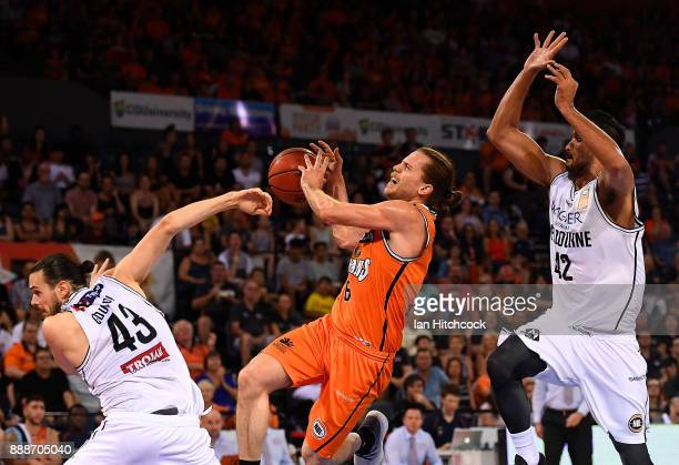 Damon Heir of the Taipans is blocked by Tai Wesley and Chris Goulding of Melbourne United contest the ball during the round nine NBL match between...