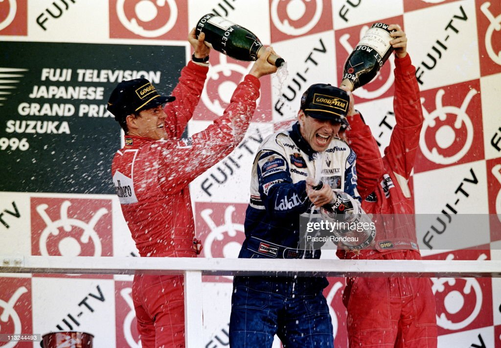 Damon Hill, driver of the #5 Rothmans Williams Renault Williams FW18 Renault 3.0 V10is sprayed with champagne after winning the Fuji Television Japanese Grand Prix by second placed Michael Schumacher and third placed Mika Hakkinen on 13th October 1996 at the Suzuka International Racing Course in Suzuka, Japan.