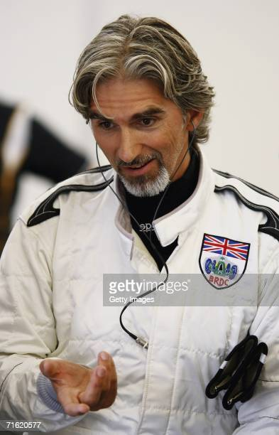 Damon Hill looks on in the garage during testing for the GP Masters of Great Britain at Silverstone Circuit on August 10 in Silverstone England