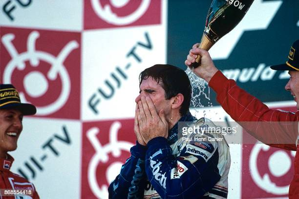 Damon Hill, Michael Schumacher, Mika Hakkinen, Grand Prix of Japan, Suzuka Circuit, 13 October 1996. Damon Hill celebrating his World Championship...