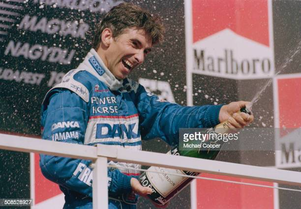 Damon Hill of Great Britain and driver of the Danka Arrows Yamaha Arrows A18 Yamaha 0X11A V10 sprays champagne to celebrate his second place at the...